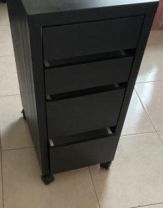Two 4 drawer storage cabinets